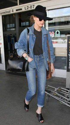 Amber Heard showed off her impeccable fashion sense by pulling off double denim look with perfection. The 30 year old actress looked splendid and gorgeous as she stepped out of the LAX airport terminal in Los Angeles on May 6, 2016 in a denim dominated ensemble comprising of faded jeans and blue denim jacket as she jetted into down after making a stunning and eye catching appearance at the Met Gala in golden gown with thigh high split.