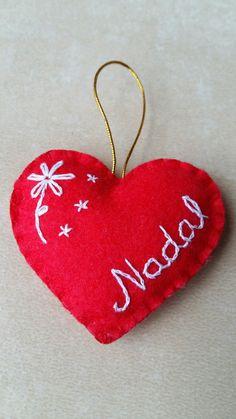 Red felt heart. Christmas ornament