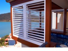Outdoor Living Areas with Aluminum Shutters = Sky high views. Exterior Shutters, Outdoor Living Areas, Sky High, Blinds, Patio, Curtains, Gallery, Inspiration, Home Decor