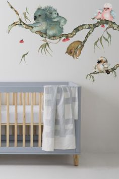 Unique Australian animal nursery wall sticker branch design. This wall sticker has been created from original watercolour artwork by Australian artist Lesley Davies. It looks fantastic above a cot, change table, drawers or coming out from a door, window or wall. #unique #wallstickers #australiannursery #australiananimals #nurserydecor