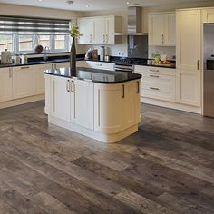 Stonegate Oak natural authentic laminate floor. Grey oak wood finish, 12mm 1-strip laminate flooring, easy to install and covered by PERGO's lifetime warranty.