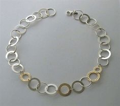Silver and gold necklace by Talma Keshet