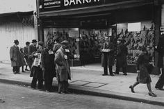 London, Oxford Street, 1940. Blind, disabled World War 1 veterans raise money by busking.