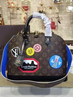 The Louis Vuitton Monogram World Tour Alma PM features creative director Nicolas Ghesquière's playful take on classic hotel stickers, which Gaston-Louis Vuitton used to collect during all his travels.  View more LV bags at http://www.luxtime.su/louis-vuitton-handbags