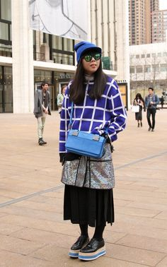 Style blogger Susie Bubble mixes patterns and textures at Lincoln Center. #nyfw #streetstyle #fashion