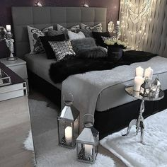 grey bedroom with lanterns and candles