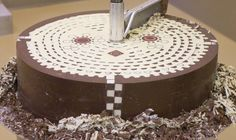 Hidden Geometric Patterns Gradually Revealed inside Giant Chocolate Cylinder geometric food chocolate