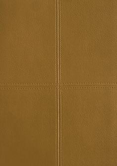 Tuscan Leather Vinyl Wallcovering Light Brown panelled faux leather wallcovering.