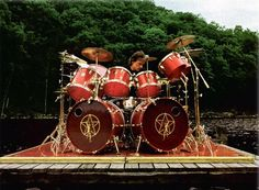 """Neil Peart of Rush, playing Tama """"Artstar"""" (prototype) on the swimming-raft of Le Studio during """"Signals"""" recording session, Great Bands, Cool Bands, Tama, Rush Band, Neil Peart, Drum Solo, Vintage Drums, Progressive Rock, Drum Kits"""