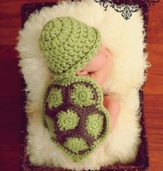 This is just precious. Baby in a turtle outfit.