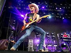 Justin Moore rocks during Faster Horses Festival at Michigan International Speedway in Brooklyn, Mich., July 18. (Scott Legato/Getty Images) #JustinMoore