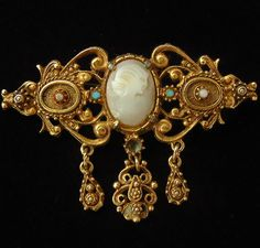 Florenza Gold tone Filigree carved Mother of Pearl cameo brooch. Originally pinned by Colleen Abbott (colleen466)