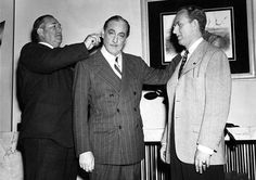 Director David Butler, John Barrymore and Kay Kyser on the set of Playmates