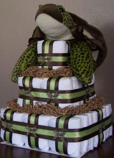 https://flic.kr/p/6xTUAd | Sea Turtle Square Diaper Cake | This Sea Turtle Square Diaper Cake is a custom order I just finished for a woman who really liked my Beary Special Delivery Square Diaper Cake but her sister in law was going with a turtle theme so I found this adorable sea turtle (the picture doesn't do this little guy justice) and created this fun diaper cake!   Blogged: www.LaDolceBoutique.blogspot.com