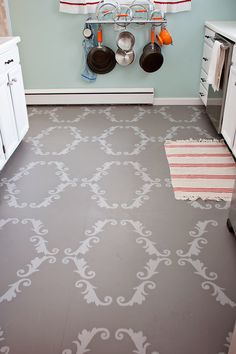 I love the stencil Erin Niehenke did to her old linoleum floors.  Awesome job Erin!  You can see the entire kitchen re-do she did at: http://creekbedthreads.com/2012/01/04/the-kitchen-finale-finally/#