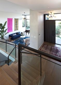 A modern home with an open entryway and formal living room off to the side.