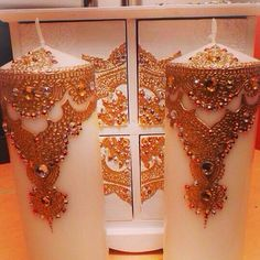 Gold and white henna decorated candles with a matching small 4 draw jewelry box.  #indianwedding #wedding #favours #favors #weddingfavours #mendhi #bespoke #design #calligraphy #candle #candles #gifts #shaadi #walima #nikah #celebrating #graduation #family #handmade #weddinggifts #desi #canvas #art #mirror #decorative #red #gold #silver #black #green #white #blue