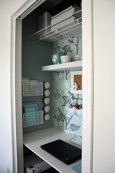 Closet office. I could really, really use this in my tiny bedroom! But then I would have nowhere to put my clothes...hm...