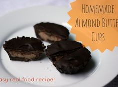 Homemade almond butter chocolates--way better than Reese's Peanut Butter Cups! Seriously awesome recipe to share today, folks. In fact, this one received possibly the most intense rave my husband has ever given any of the foods I've made. I wish I had it recorded because it was super funny and flattering--all for these simple little homemade almond butter cups!