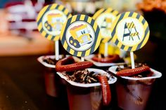 Dirt cups at a construction party! Easy! Just get choclate pudding...sprinkle crushed up oreos...and add a gummi worm! :-)