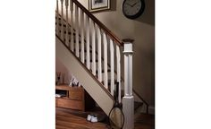 This is a Boyne staircase design - Handrail, Base rail, Steps, Newel post caps: Walnut; Spindles and newel posts: Primed.