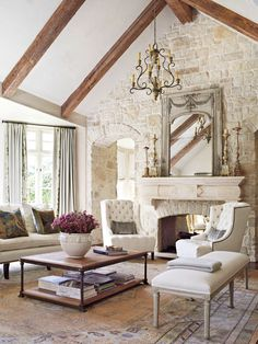 Shabby-Chic living room with cathedral beam ceiling, arched doorway, stone brick wall, stone fireplace and carpet flooring.