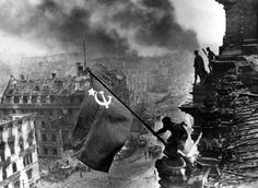 Yevgeny Khaldei--raising the Soviet flag over the Reichstag during the Battle of Berlin, 2 May 1945