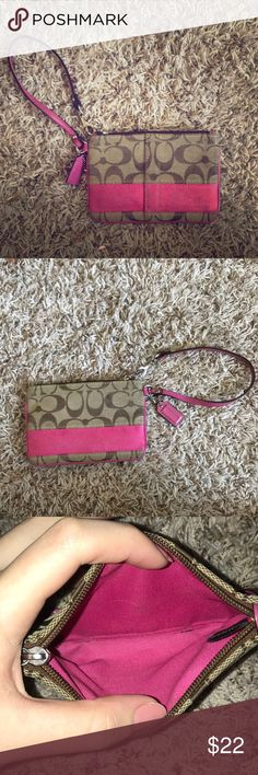 Coach Wristlet Gently used pink accented Coach wristlet Coach Bags Clutches & Wristlets