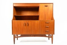 Gorgeous mid century modern tall teak credenza from G Plan's Scandinavian Range. Designed by Victor Wilkins in the mid 1960′s, this excepti...