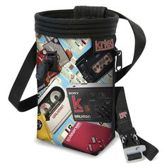 """Retro Mixed Tapes Chalk Bag. Classic Handmade bag with Water-Resistant Rip-Stop, plated with a Unique Eco-Canvas Print, Reinforced with heavy nylon webbing. Polartek Fleece Lining with an adjustable Snag-Free Draw Cord, and 2"""" elastic grip to keep your chalk clean and where it needs to be. Zippered Pocket which fits the average-sized phone, so take a photo from the top or stash a snack. Adjustable Waist Band with a featured whistle buckle. Life-time Warranty. We love to see our bags used...."""