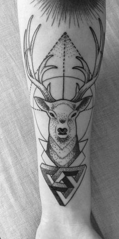Someone's nice deer and geometry tattoo, done by Sharky at Tía Juana Tattoos.