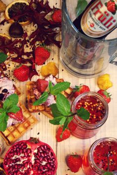 Waffles with blackcurrant cream, strawberry pomegranate beer cocktail
