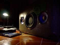 Old suitcase transformed into amplified stereo speaker