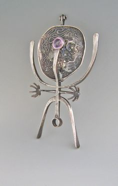 Pendant   Bob Winston.  Sterling silver with a pink stone/glass.  ca 1950s