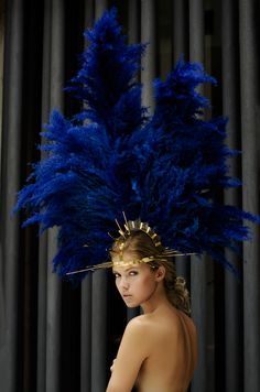 blue feathers. feather hat. showgirl.