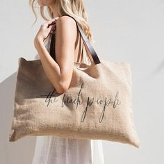 Our essential jute bag is just what you need for the markets, beach, and home. Jute material with leather handles and a sand-free design that hides stains. Jute Tote Bags, Burlap Bags, Jute Bags Manufacturers, Jute Shopping Bags, The Beach People, Ethno Style, Jute Fabric, Leather Stamps, Cotton Bag