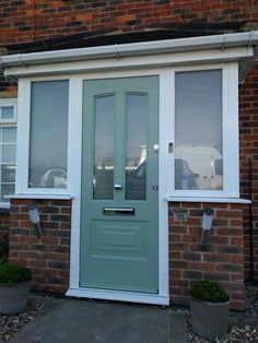 Chartwell green, composite door fitted in borehamwood cottage front Porch Doors Uk, Porch Uk, Cottage Front Doors, Porch Windows, House Front Porch, Green Front Doors, Front Porch Design, Windows And Doors, Porch Entrance