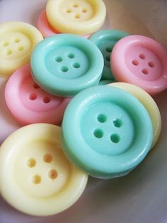 Don't be fooled, those aren't the kind of buttons you would sew on your jacket. Those cute as a button soaps would be more at home next to your bathroom sink!