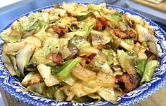 FRIED CABBAGE & ONIONS   3-4 pieces bacon, chopped *   1 pound cabbage, coarsely chopped, about 1 small head   1 small onion, coarsely, 2 1/2 ounces   Salt and pepper, to taste   In a large skillet, fry the bacon until almost crisp. Add the cabbage and onions to the skillet; cook and stir until the cabbage is wilted and lightly browned. Season with salt and pepper
