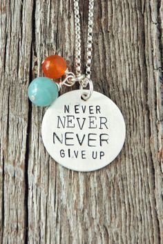"""""""Never, never, never give up."""" -Winston Churchill This necklace is a great reminder of so many things that are worth fighting for. This 7/8"""" Sterling silver charm is hand-stamped with """"Never Never NEV"""