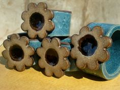 Ceramic Flower Napkin Rings in Sand and Dark Teal with melted brown glass Rustic Kitchen, Country Kitchen, Kitchen Decor, Brown Teal, Dark Teal, Pottery Patterns, Napkin Holders, Ceramic Flowers, Clay Ideas