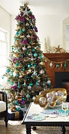 Want to try something different this holiday season. How about a turquoise and purple Christmas tree? The calming hues of turquoise oceans, translucent sea glass and golden sands evoke a sophisticated seaside holiday. Purple Christmas Tree, Peacock Christmas, Christmas Tree Themes, Coastal Christmas, Holiday Tree, Holiday Decor, Holiday Ideas, Christmas Crafts, Xmas Tree Decorations