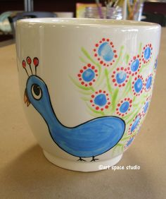 other side of the teacher mug .. students fingerprints are the feathers!