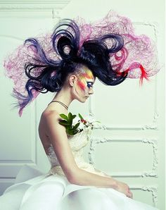 A long black wavy coloured multi-tonal sculptured avant-garde hairstyle by Avant Garde Collections