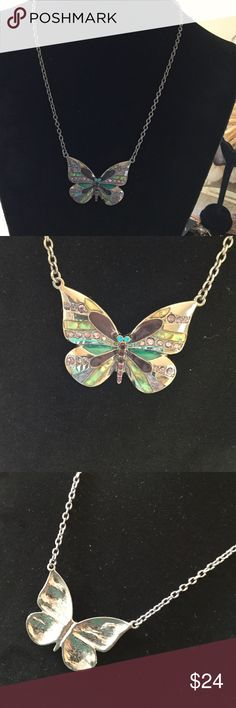 "ParkLane close outs Butterflies Are Free, well almost. Gorgeous butterfly necklace attached to a gunmetal color chain . Lobster claw clasp. Butterfly has enameled colors of purple,turquoise . Necklace length is 16"" with 3"" extender. Butterfly is 1.5 "" wide. Chain looks silver, but the color is black gunmetal Park Lane Jewelry Necklaces"