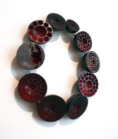 VERA SIEMUND-DE- necklace, 2011, enamelled steeldrilled, sawn, embossed, enamelled, mounted - 220 x 260 x 35 mm - steel hemispheres, red enamelled inside, drilled pattern sawn portrait
