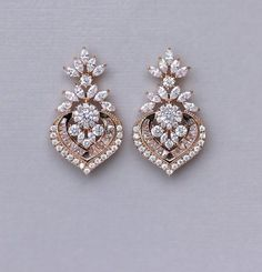 Chic and elegant rose gold crystal bridal earrings in a Deco chandelier style, Taylor earrings will create the most stunning accessory for your