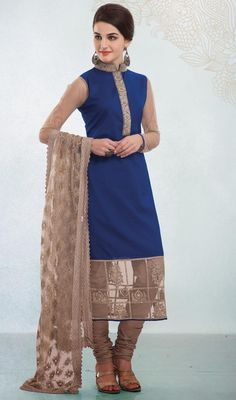 Blue and beige cotton churidar suit flaunts elegance with the embellished foliage patches on the collar and placket. Contrasting hemline patch with embroidered motifs give a twist the look. #NewLatestDesignerSuit