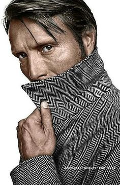 Mads Mikkelsen using the tweed coat collar for cheek bone support.