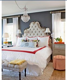 Wall color, curtain rod height, reading lamps on wall, head board, wood floors with large rug